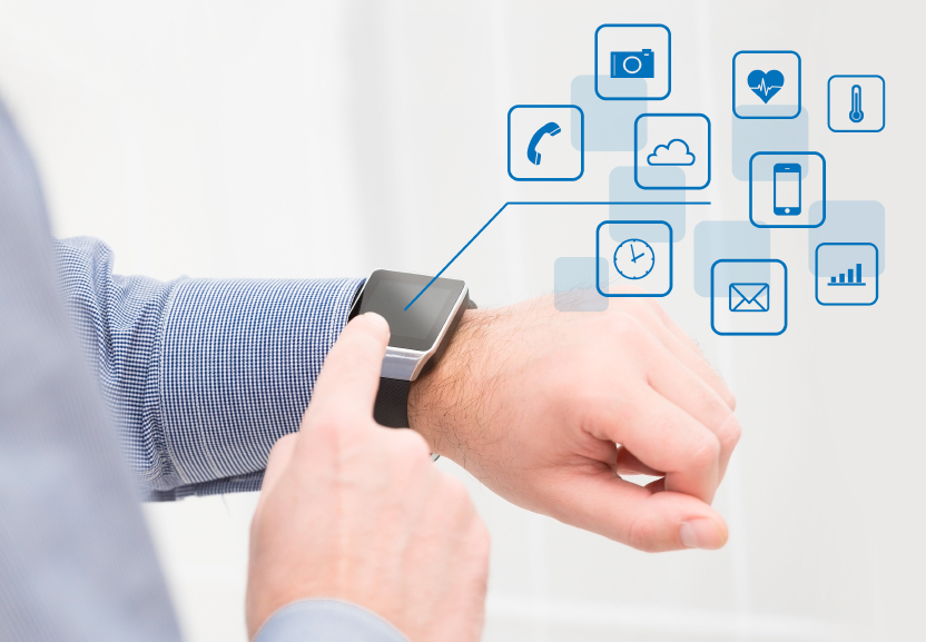 Wearing touchscreen smartwatch with app icons.